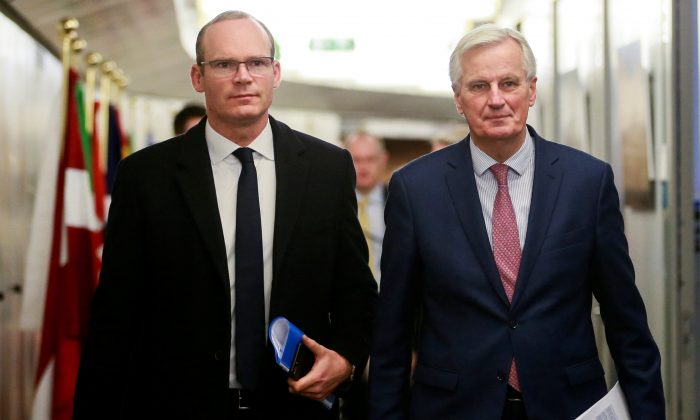 Ireland's Foreign and Trade Minister Simon Coveney and European Union's chief Brexit negotiator Michel Barnier arrive for a meeting in Brussels, Belgium, March 19, 2018. (Olivier Hoslet/Pool via Reuters)