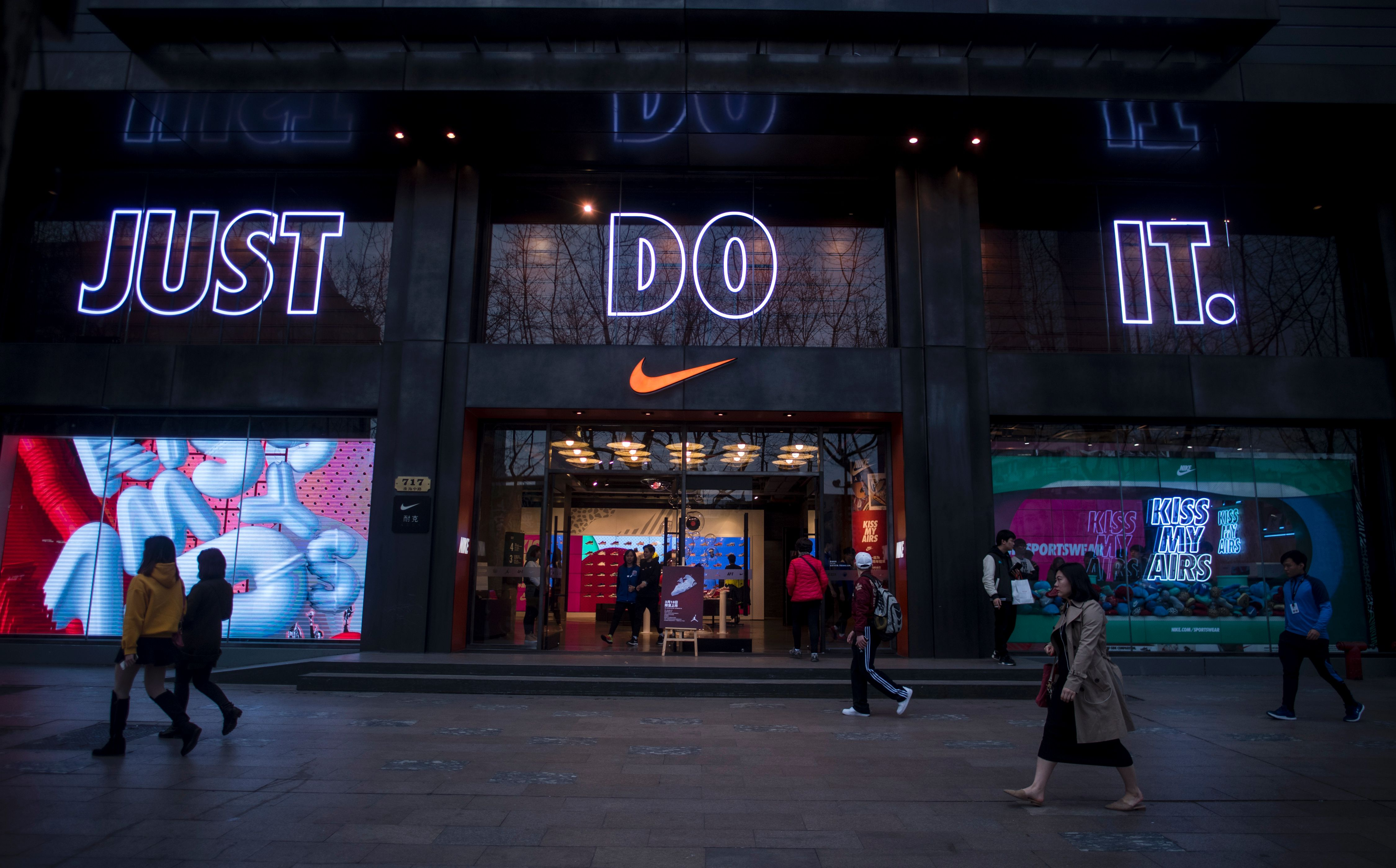 Chinese imitation of air jordan shoe brand countersues nike for people pass by the flagship store of sporting goods giant nike in shanghai china on march 16 2017 johannes eiseleafpgetty images buycottarizona Choice Image