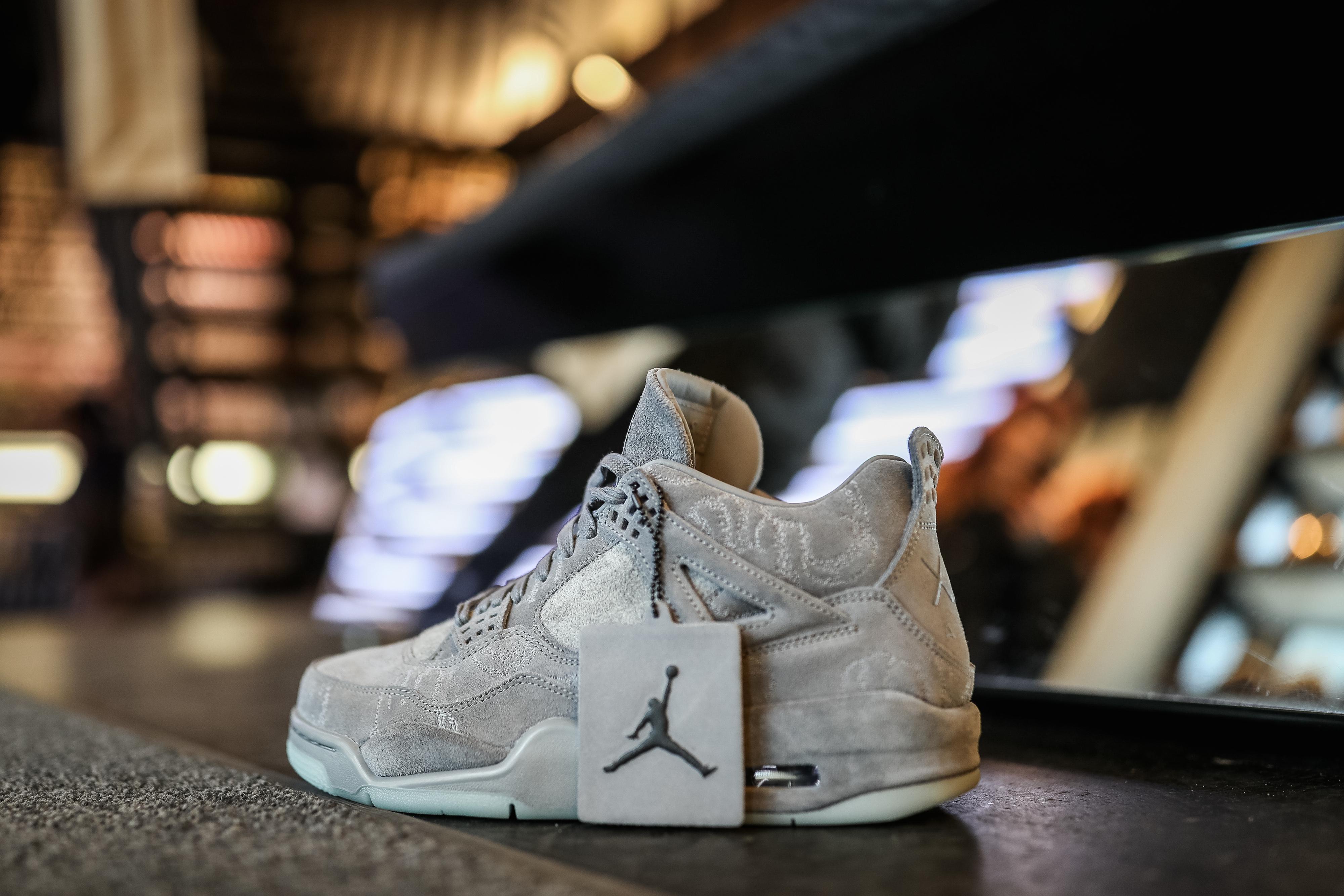 Chinese imitation of air jordan shoe brand countersues nike for kaws x air jordan iv sneakers at a sneakers store in berlin germany on march 31 2017 maja hitijgetty images buycottarizona Choice Image