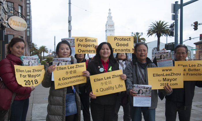 Ellen Lee Zhou (C) surrounded by her supporters along the Embarcadero in San Francisco on March 13, 2018.  Zhou is one of the 8 candidates in the June 5 special election San Francisco mayor race. (The Epoch Times)