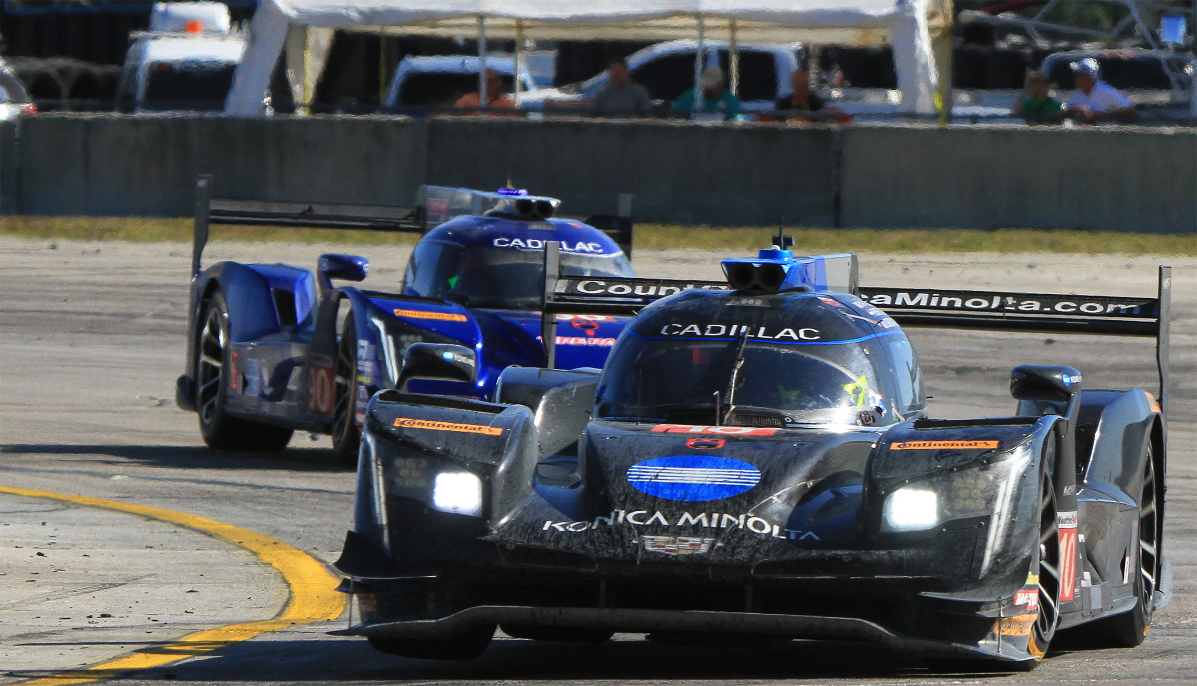 The #10 WTR Cadillac DPi gets two wheels in the air coming through Turn 17. The bumps at Turn 17 caused a couple of wrecks at the 2018 12 Hours. Cars can bounce sideways as well as up and down—that's how the #6 Acura got knocked out, and the Frank Montecalvo in the #64 Scuderia Corsa Ferrari ended up on its roof after hitting the spinning #52 AFS/PR1 Ligier. (Chris Jasurek/Epoch Times)