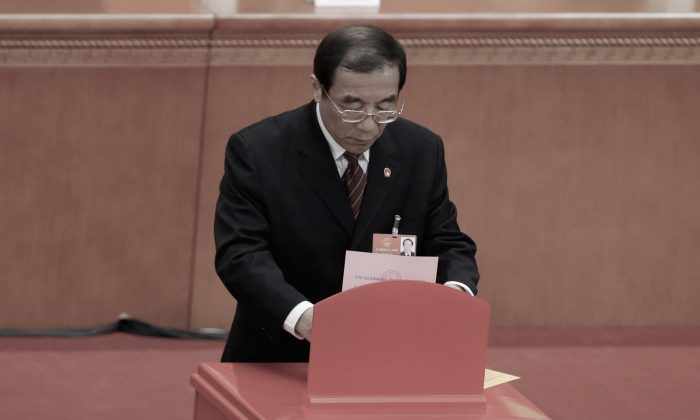Yang Xiaodu, the newly appointed head of the anti-corruption super agency, the National Supervision Commission, drops his ballot during a session of the rubber-stamp parliament, the National People's Congress, at the Great Hall of the People in Beijing, China, on March 18, 2018. (Jason Lee/Reuters)
