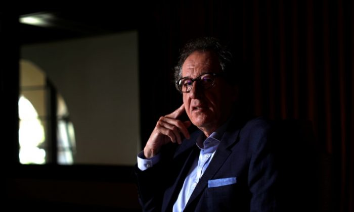 """Cast member Geoffrey Rush poses for a portrait while promoting the upcoming movie """"Pirates of the Caribbean: Dead Men Tell No Tales"""" in Beverly Hills, California U.S., May 20, 2017.  (Reuters/Mario Anzuoni)"""