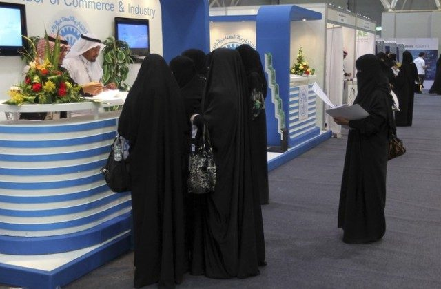 Saudi Arabian women, seeking a job, talk with recruiters during a job fair in Riyadh Jan. 25, 2012.  (Reuters/Stringer)