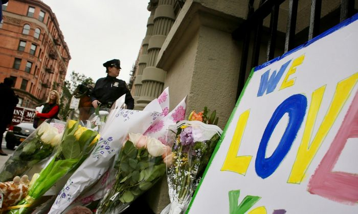 Flowers and messages are left in front of the building where two children were stabbed to death allegedly by their nanny in the family's quiet Upper West Side apartment, on Oct. 26, 2012 in New York City. (Spencer Platt/Getty Images)