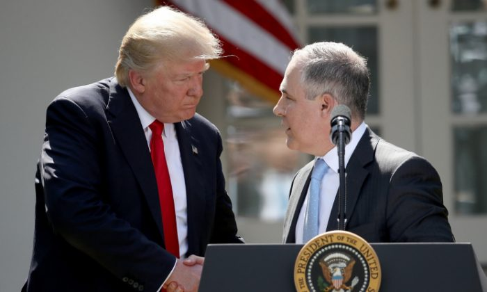 U.S. President Donald Trump shakes hands with EPA Administrator Scott Pruitt after announcing his decision for the United States to pull out of the Paris climate agreement in the Rose Garden at the White House in Washington, DC on June 1, 2017. (Win McNamee/Getty Images)