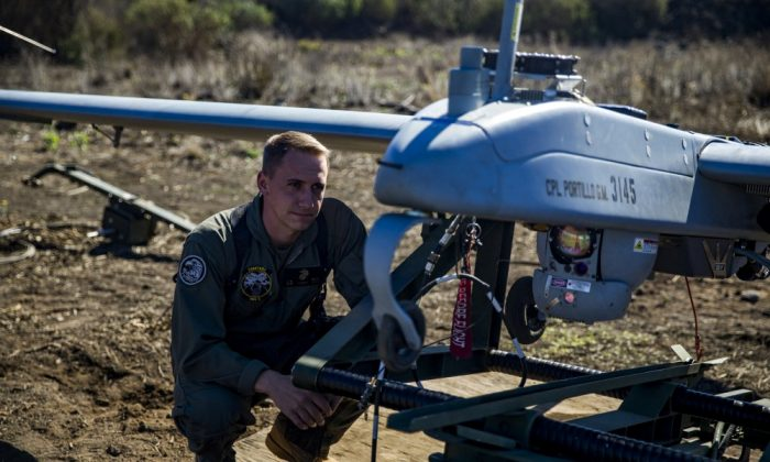 U.S. Marine Staff Sgt. James Smith inspects an RQ-7B Shadow unmanned aerial vehicle, commonly known as a drone, during preflight checks at the Pohakuloa Training Area, on the island of Hawaii, in October 2017.  (U.S. marine Corps Sgt. Ricky Gomez/via Reuters)