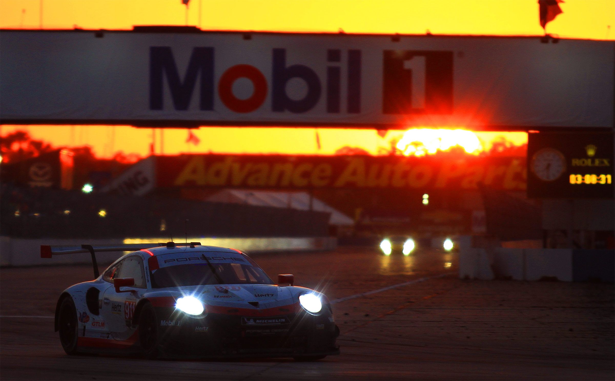 The #911 Porsche got faster as the day got later, leaving behind the #62 Risi Ferrari and eventually winning its duel with the #25 BMW. (Chris Jasurek/Epoch Times)