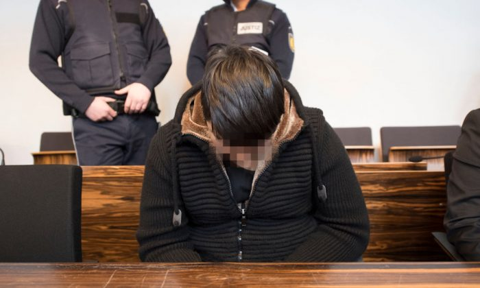 Hussein Khavari , convicted of raping and killing a young woman in October 2016, sits in a court room prior to the expected proclamation of sentence at the regional court in Freiburg, southern Germany, on March 22, 2018.(THOMAS KIENZLE/AFP/Getty Images)