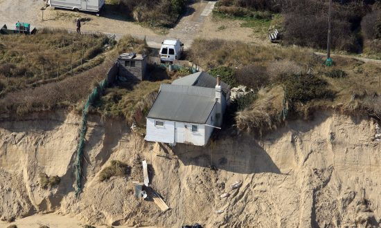 Jaw-Dropping Drone Footage Shows Homes Teetering on Cliff Edge After Storm Washes Ground Away