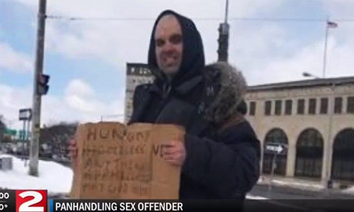 Dewayne Denis, a Level 3 sex offender, panhandles on the sidewalks of Utica, New York (Screenshot via WKTV)