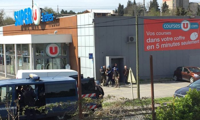 Police are seen at the scene of a hostage situation in a supermarket in Trebes, Aude, France March 23, 2018 in this picture obtained from a social media video. (La vie a Trebes/via Reuters)