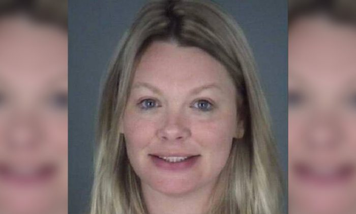 Carol Lynn Stone was charged with domestic battery by Pasco County Sheriff's Office. (Pasco County Sheriff's Office)