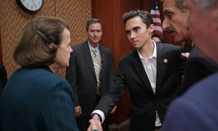 Sen. Dianne Feinstein (D-CA) (L) greets Marjory Stoneman Douglas High School shooting survivor David Hogg ahead of a news conference in the U.S. Capitol Visitors Center in Washington on March 22, 2018.