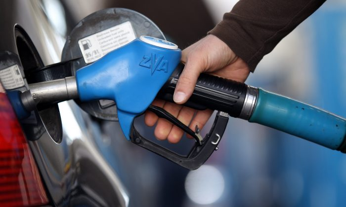 A man pump gas in a file photo. (Photo Illustration by Miguel Villagran/Getty Images)