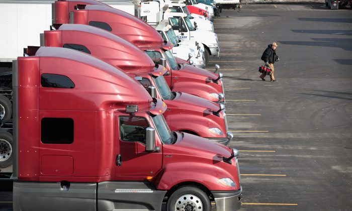 Trucks sit in the lot of a service facility in Chicago on Jan. 25, 2018. Near-record levels of freight volume driven by an improving economy and new federal safety regulations have contributed to a nationwide truck shortage. (Scott Olson/Getty Images)