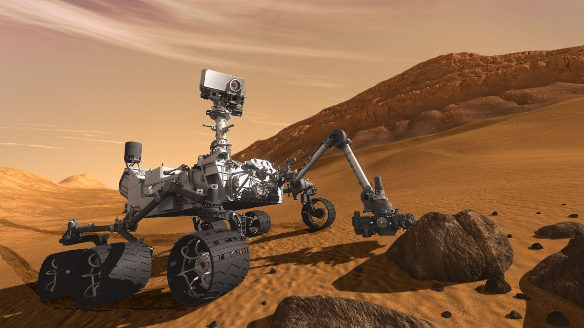 This is what the Curiosity might look like, rolling across Martian terrain, gathering data. (NASA/JPL-Caltech)