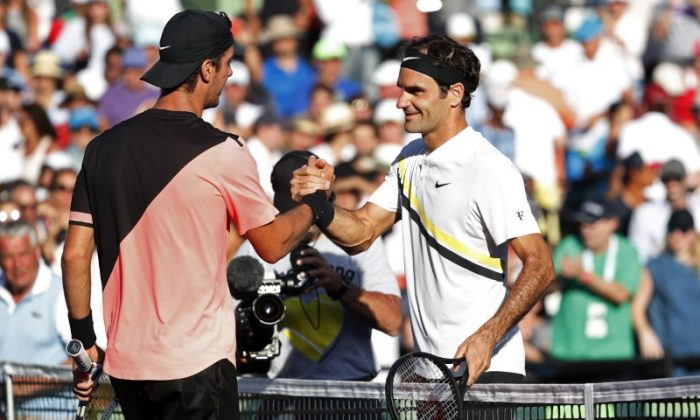Thanasi Kokkinakis of Australia (L) shakes hands with Roger Federer of Switzerland (R) after their match on day five of the Miami Open at Tennis Center at Crandon Park on Mar 24, 2018, in Key Biscayne, FL, USA. Kokkinakis won 3-6, 6-3, 7-6(4). (Geoff Burke-USA TODAY Sports)
