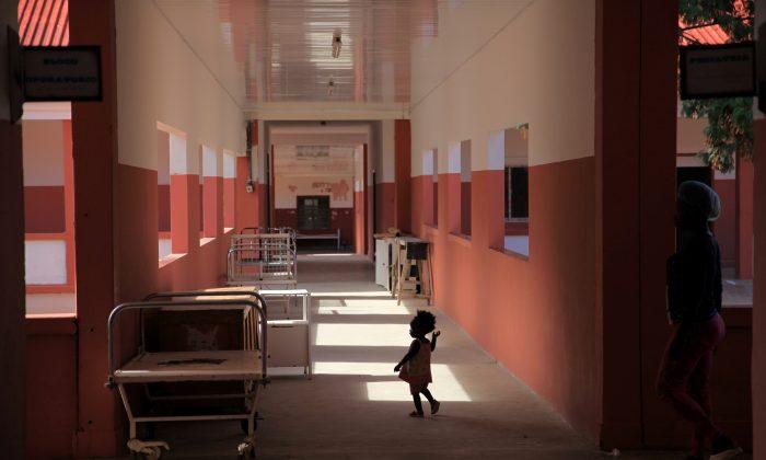A toddler runs through Chiulo Hospital in Cunene province, Angola February 24, 2018. (Reuters/Stephen Eisenhammer)