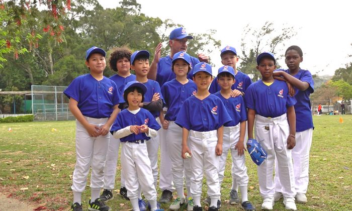 """Patrick Calkins (coach) together with some of his """"Tai Po Indians"""" baseball team that played the league leaders """"Bombers"""" in the HK Baseball Association's new Coach Pitch league at Fanling on Saturday March 17, 2018. (Bill Cox)"""