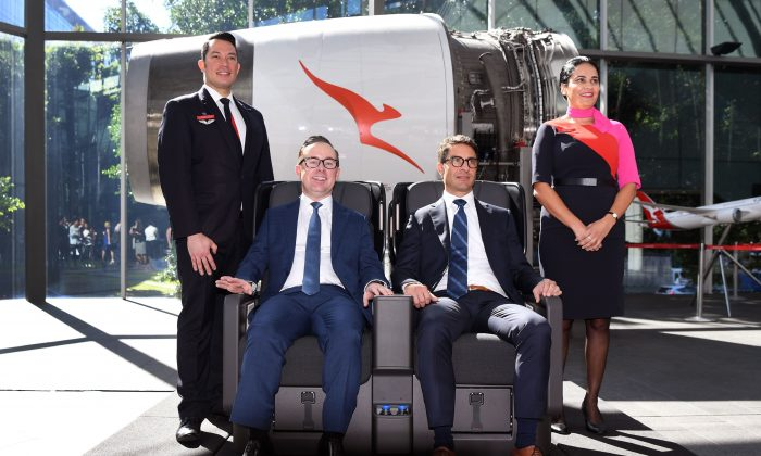 Qantas chief executive officer Alan Joyce (2nd L) and chief financial officer Tino La Spina (2nd R) test out the premium economy seat for the airline's new 787-9 Dreamliner after a press conference in Sydney on Feb. 23, 2017. (WILLIAM WEST/AFP/Getty Images)