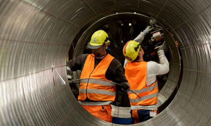 Workers constructing pipes at the Nord Stream 2 facility in Sassnitz, Germany, on October 19, 2017 ( Carsten Koall/Getty Images)
