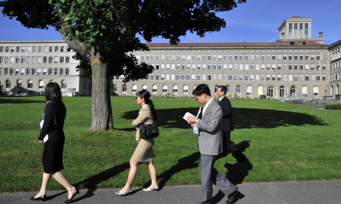 Chinese officials walk in front the World Trade Organization headquarters on July 22, 2008 in Geneva. (Fabrice Coffrini/AFP/Getty Images)