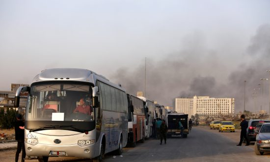 Thousands Leave Ghouta in Surrender of Enclave to Syrian Government
