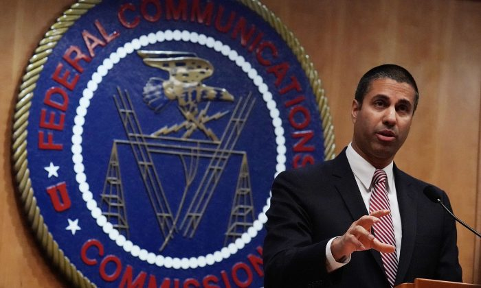 Federal Communications Commission Chairman Ajit Pai speaks to members of the media after a commission meeting Dec. 14, 2017, in Washington. (Alex Wong/Getty Images)