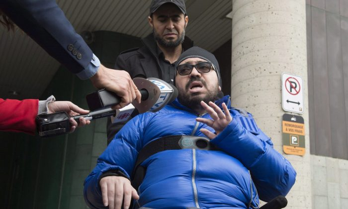 Aymen Derbali reacts to Alexandre Bissonnette's guilty plea at the hall of justice in Quebec City on March 28, 2018. Derbali was injured during the 2017 mosque shooting and has been paralyzed since. (The Canadian Press/Jacques Boissinot)
