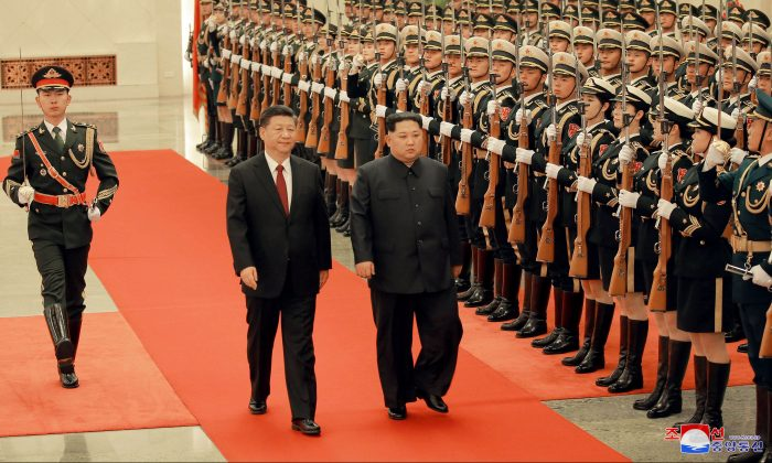 North Korean leader Kim Jong Un and Chinese leader Xi Jinping inspect honor guards as Kim paid an unofficial visit to Beijing in this undated photo released by North Korea's Korean Central News Agency (KCNA) in Pyongyang on March 28, 2018. (KCNA/via Reuters)
