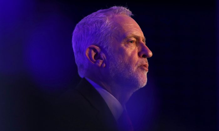 FILE PHOTO: Britain's opposition Labour Party leader Jeremy Corbyn answers questions after speaking to the EEF Manufacturer's Organisation, in London, Feb. 20, 2018. REUTERS/Simon Dawson/File Photo