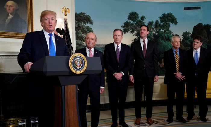 U.S. President Donald Trump, flanked by Commerce Secretary Wilbur Ross, U.S. Trade Representative Robert Lighthizer, White House Homeland Security Advisor Tom Bossert, Assistant to the President Peter Navarro and Deputy Assistant to the President for International Economic Affairs Everett Eissenstat, delivers remarks before signing a memorandum on intellectual property tariffs on high-tech goods from China, at the White House in Washington, D.C., on March 22, 2018.  (Jonathan Ernst/Reuters)