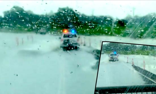 Police Escort Trucks through Floodwaters in Australia