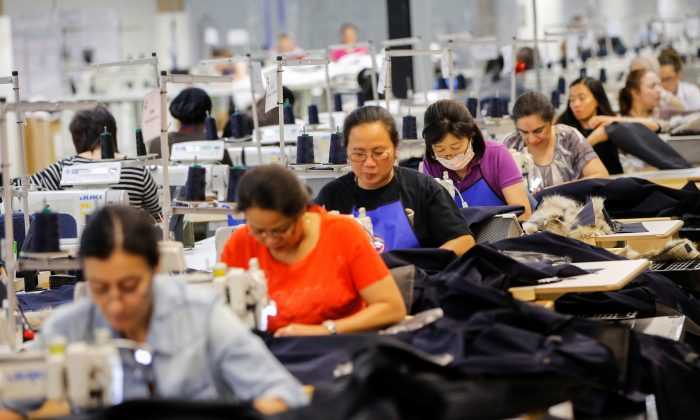 Workers make jackets at the Canada Goose factory in Toronto, Ontario, Canada, February 23, 2018.   (REUTERS/Mark Blinch)