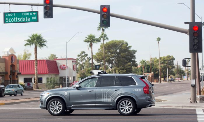 FILE PHOTO: A self driving Volvo vehicle, purchased by Uber, moves through an intersection in Scottsdale, Arizona,  Dec. 1, 2017.   (REUTERS/Natalie Behring/File Photo)