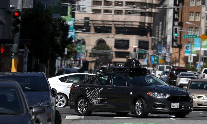 An Uber self-driving car drives down 5th Street in San Francisco, California on March 28, 2017.  (Justin Sullivan/Getty Images)