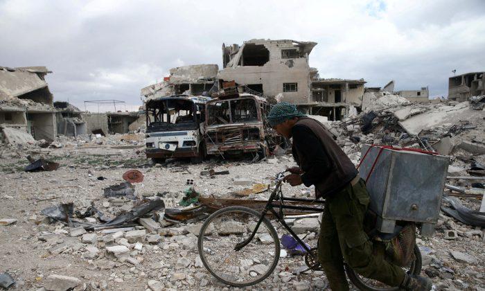 Syria: Fighters begin leaving Ghouta's last rebel-held town