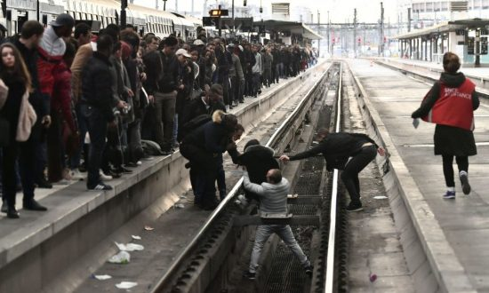 French Rail Unions Take on Macron With Mass Rolling Strikes