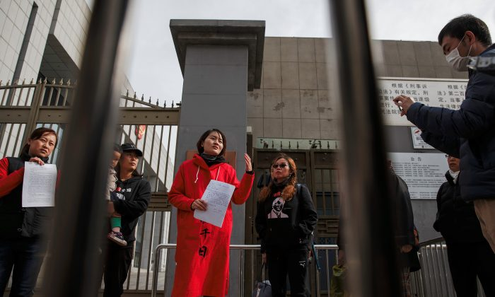 Li Wenzu, wife of detained Chinese rights lawyer Wang Quanzhang, talks to reporters outside a Supreme People's Court complaints office in Beijing, China, April 4, 2018. (Reuters/Damir Sagolj)