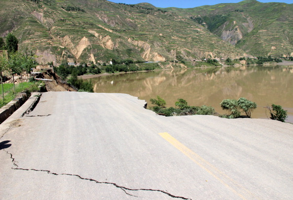 This picture taken on July 22, 2013 shows a damaged highway after a pair of shallow earthquakes hit the area in Dingxi, in northwest China's Gansu province. (STR/AFP/Getty Images)
