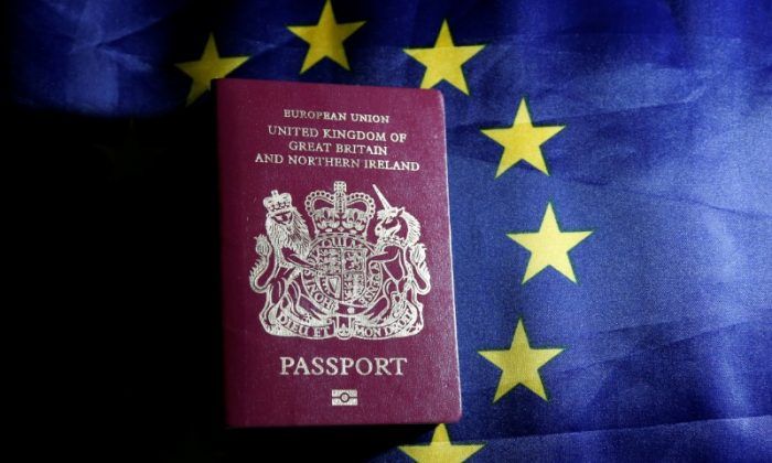 A British passport is pictured in front of an European Union flag in this photo illustration taken in Brussels, Belgium, June 20, 2016. (Reuters/Francois Lenoir/Illustration/File Photo)