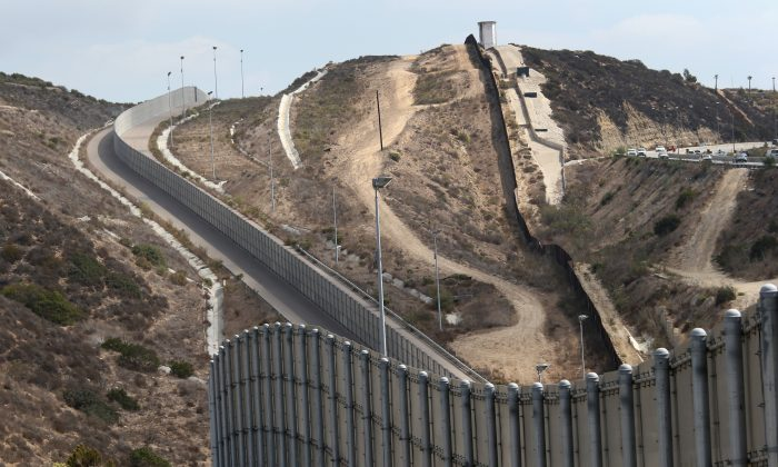 Newer and older sections of the U.S.-Mexico border fence climb a hill on Oct. 3, 2013 near San Diego, California. (John Moore/Getty Images)