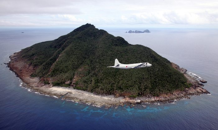 A P-3C maritime patrol aircraft of the Japanese Maritime Self-Defense Force flying over the disputed Senkaku Islands in the East China Sea on Oct. 13, 2011. (Japan Pool/AFP/Getty Images)