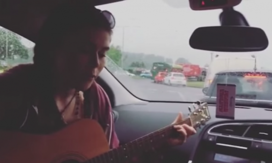 After being stuck in traffic for 4 hours, she picks up guitar—i'm completely blown away