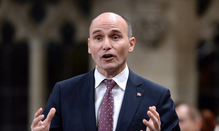 Social Development Minister Jean-Yves Duclos rises in the House of Commons on Feb. 7, 2018. (The Canadian Press/Justin Tang)