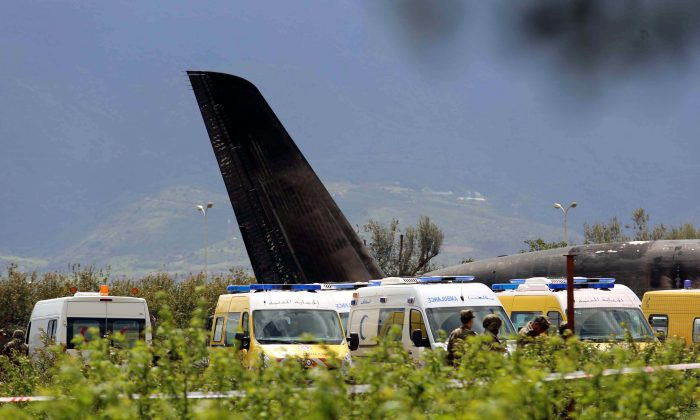 An Algerian military plane is seen after crashing near an airport outside the capital Algiers, Algeria, April 11, 2018 (Reuters/Ramzi Boudina)