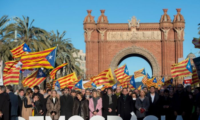 TOPSHOT - Former President of the Catalan Government and leader of Partit Democrata Europeu Catala (Catalan European Democratic Party) PDECAT Artur Mas (between R and A letters) poses with other members of Catalan Government, the Catalan Parliament, Catalan mayors and party members few moments before his arrival at the TSJC (Superior Court of Catalonia) in Barcelona on Feb. 6, 2017. (Photo credit should read JOSEP LAGO/AFP/Getty Images)