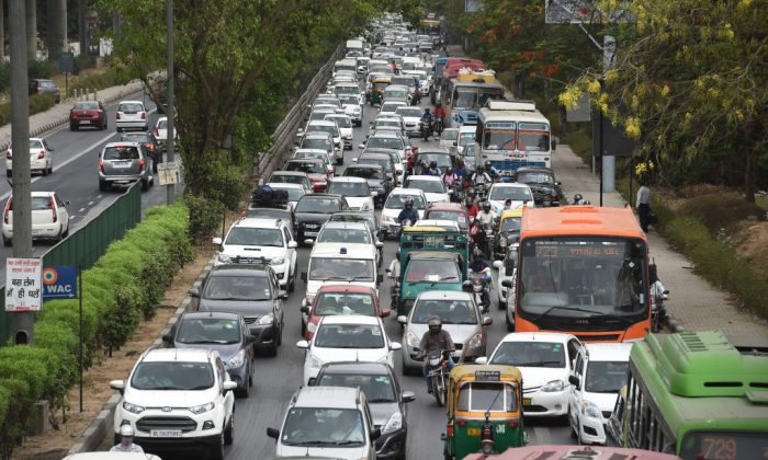 Indian commuters travel in a traffic jam on their way to Gurgaon from New Delhi on May 3, 2016.    (Money Sharma/AFP/Getty Images)