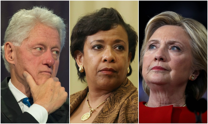 Former President Bill Clinton, Attorney General Loretta Lynch, and former presidential candidate Hillary Clinton. (Bryan R. Smith and Justin Sullivan/Getty Images)